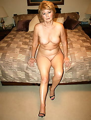 Fantastic mature grandma is fingering her leaking cunt