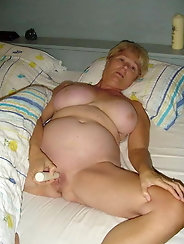 Pretty-looking aged milf is fingering her leaking hole