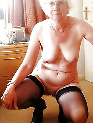 Mature dame is touching herself