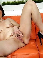 Lady is fingering her pussy
