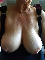 Dissolute older gilf is playing with her dildo