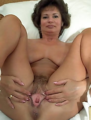 Shy granny shows her pussy
