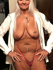 Busty mature businesswoman is revealing her jugs