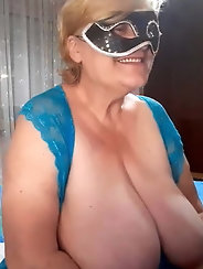 Granny  with big tits wearing mask